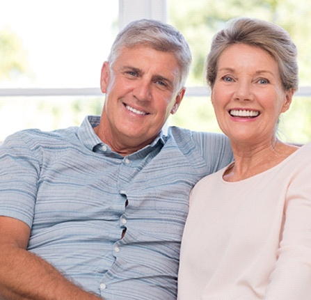 Happy older couple with dental implants