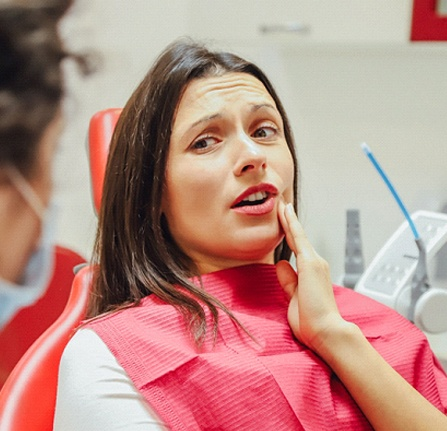 Woman talking to dentist about wisdom tooth extraction